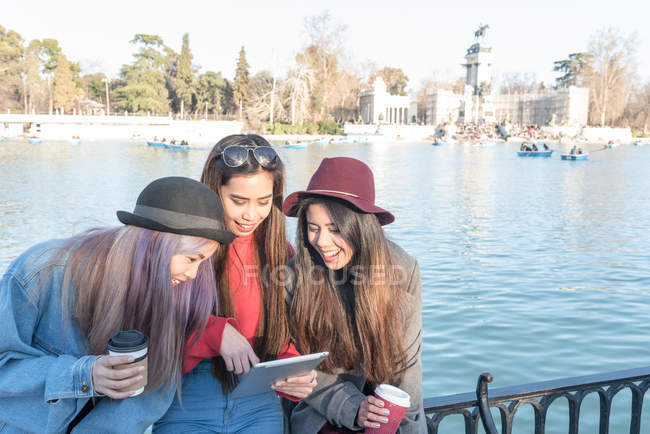 Young Long Hair women browsing and looking at her tablet, Spain — Stock Photo