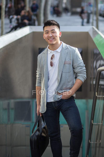 Portrait of a cheerful chinese businessman in the street, Spain — Stock Photo