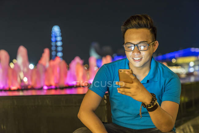 Young Man Playing With His Smartphone In City — Stock Photo