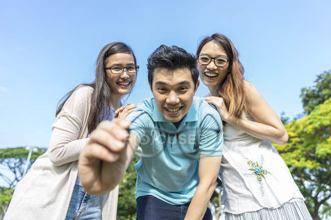 Group of young asian friends having fun outdoors — Stock Photo