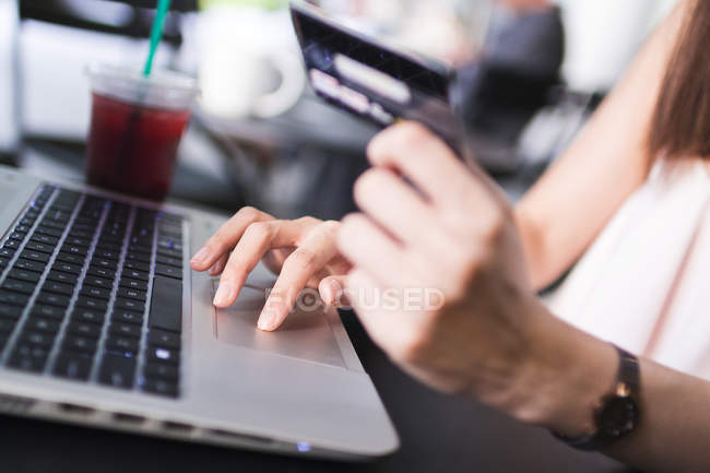 Cropped Image Of Girl Making A Transaction On Her Laptop. — Stock Photo