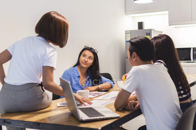 Colleagues Discussing Work In Startup Environment — Stock Photo