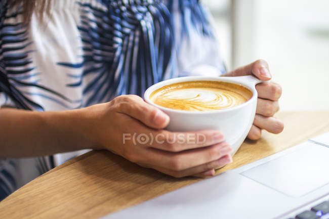 Cropped Image Of Woman Holding Up A Cup Of Coffee — Stock Photo