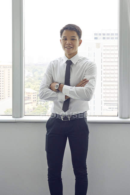 Young asian business man at work in modern office — Stock Photo