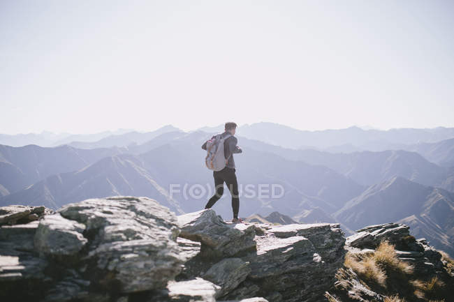 Back view of a young man trekking through Mountain Cook National Park in New Zealand — Stock Photo