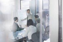 Businessman leading a presentation — Stock Photo