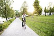 Businessman riding bicycle — Stock Photo