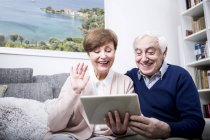 Couple making video call with tablet — Stock Photo