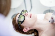 Woman receiving vascular laser treatment — Stock Photo