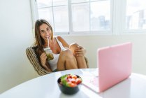 Smiling young woman relaxing at home — Stock Photo