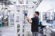 Man working in factory shop floor — Stock Photo