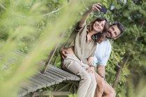 Couple taking selfie on footbridge — Stock Photo
