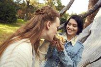 Best friends eating sandwich — Stock Photo