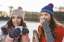 Women drinking hot beverages — Stock Photo