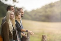 Friends standing and looking at field — Stock Photo