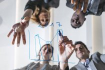 Business people drawing chart — Stock Photo