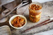 Fresh homemade kimchi with chopsticks — Stock Photo