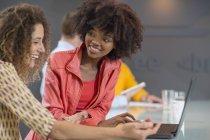 Women in office sharing laptop — Stock Photo