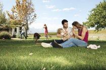 Happy family having fun in garden — Stock Photo