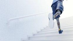 Robot running up stairs — Stock Photo