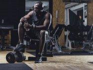 Athlete sitting in gym — Stock Photo