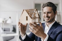 Architect examining architectural model — Stock Photo