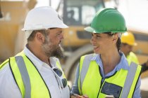 Male and female quarry workers — Stock Photo