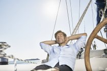 Mature man relaxing on sailing boat — Stock Photo