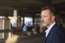 Businessman waiting at bus terminal — Stock Photo