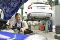 Mechanic examining car — Stock Photo