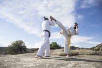 Men doing combat exercises — Stock Photo