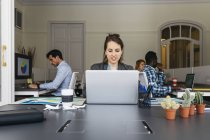 Businesswoman using laptop — Stock Photo