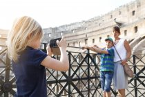 Girl taking picture of mother and brother — Stock Photo