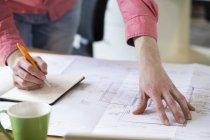 Man working on blueprint — Stock Photo