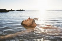 Relaxed man floating in sea — Stock Photo