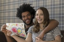 Couple showing children drawing — Stock Photo