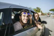 Young man and woman in car — Stock Photo