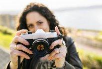 Woman holding retro camera — Stock Photo