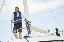 Man on sailing boat — Stock Photo