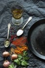 Olive oil, herbs and spices and an old iron pan — Stock Photo