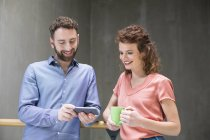 Man and woman with phone and cup of coffee — Stock Photo