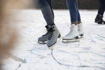 Feet of ice skating people — Stock Photo