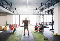 Seniors exercising with personal trainer — Stock Photo