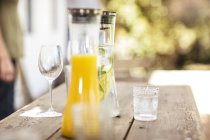 Carafes with refreshing drinks — Stock Photo