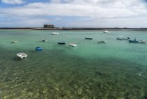 Spain, Lanzarote, Arrecife, fishing harbour and the Castle of San Gabriel — Stock Photo