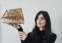 Woman looking at architectural model — Stock Photo