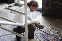 Architect sharping pencil with angle grinder — Stock Photo