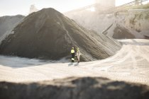 Workers standing at quarry — Stock Photo