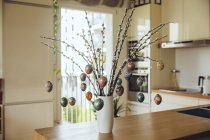 Easter eggs hanging on branches as decorative composition for Easter holidays — Stock Photo