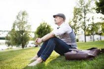 Businessman sitting on grass — Stock Photo